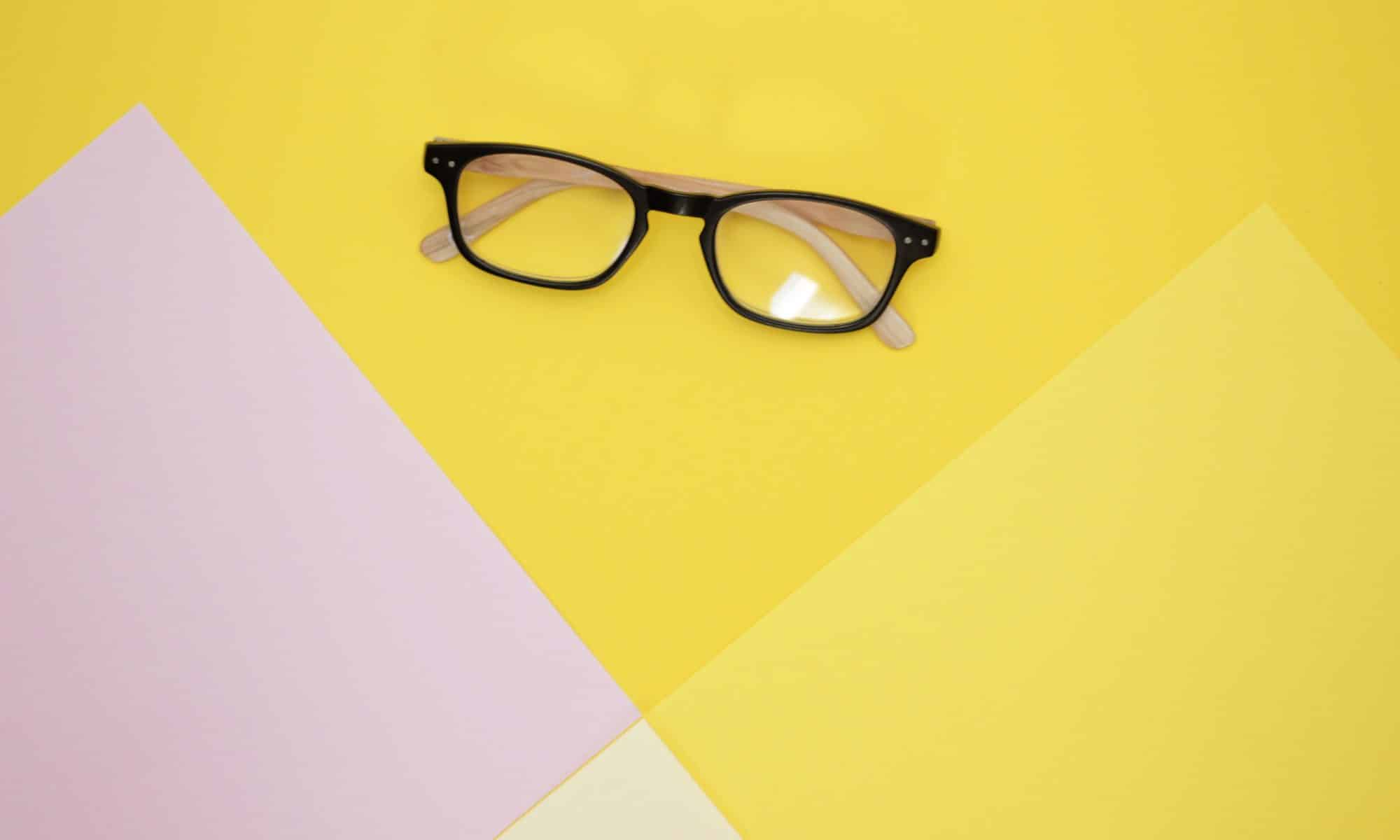 Closed glasses on a yellow table